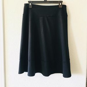 Black pull on knee length skirt, M